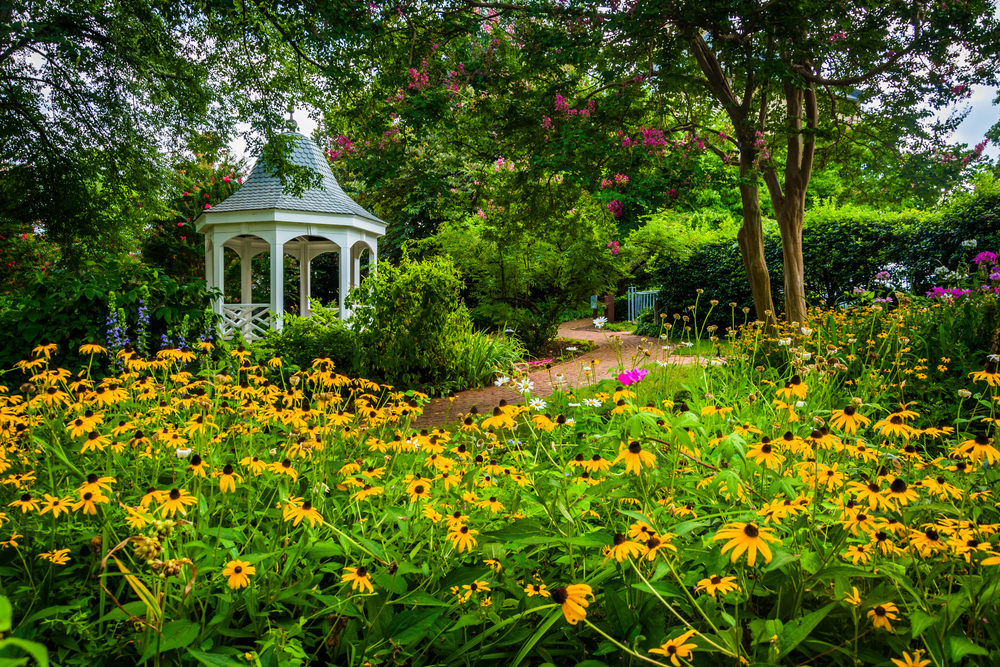 Colorful garden and gazebo in a park in Alexandria, Virginia.