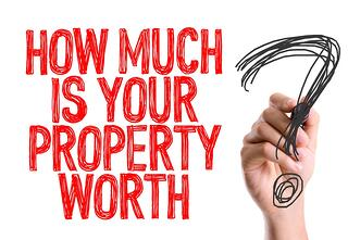 Hand with marker writing How Much Is Your Property Worth?.jpeg