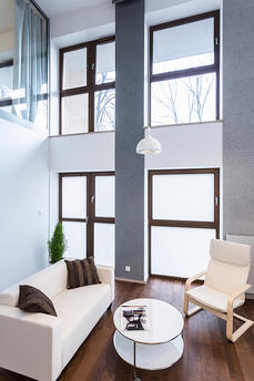 Image of high wall with big windows in modern lounge