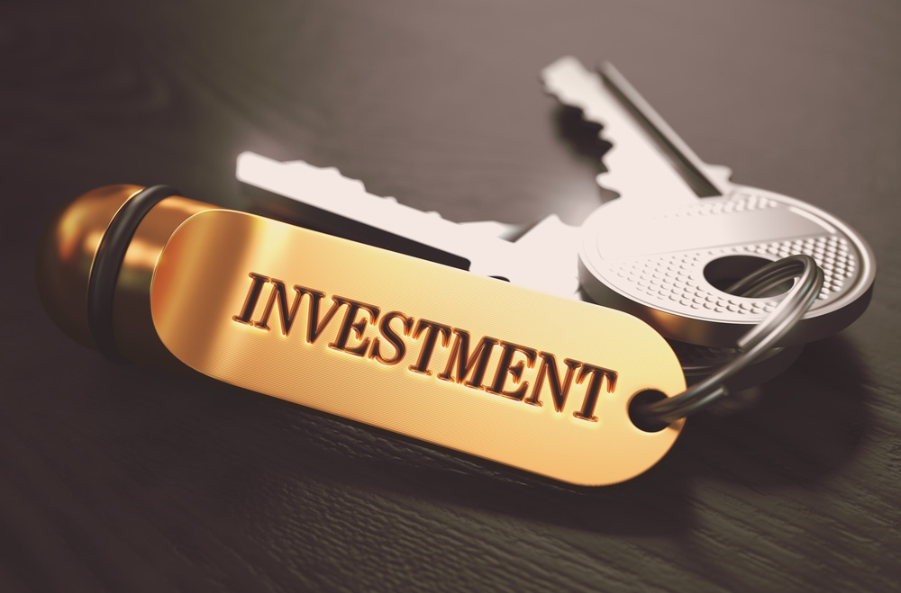 Keys with Word Investment on Golden Label over Black Wooden Background. Closeup View, Selective Focus, 3D Render. Toned Image..jpeg