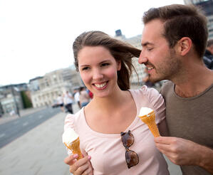 Romantic couple enjoying an ice cream outdoors