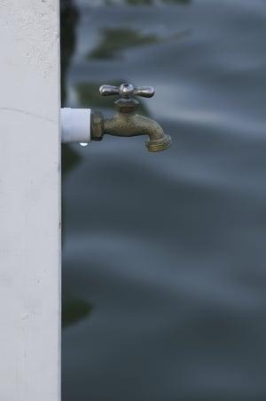 Water faucet at edge of dock