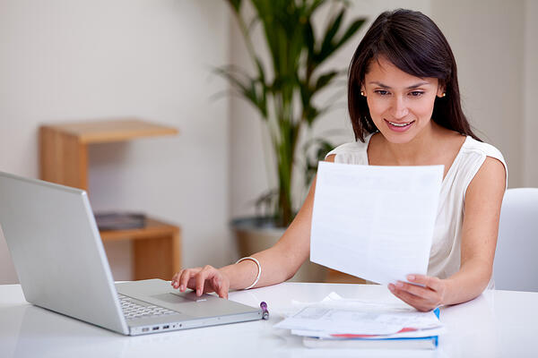 Woman working at home on a laptop computer
