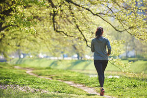 young woman jogging in city park at early morning-1