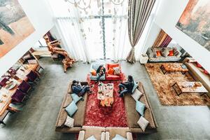 aerial-photography-of-three-people-sitting-on-sofa-2029715
