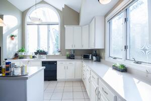 empty-kitchen-with-white-wooden-cabinet-1838065